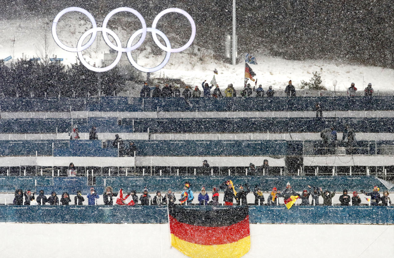 <p>Fans watch in the snow during the venue ceremony for the Men's Nordic Combined Team Cross-Country Skiing event at the 2018 Winter Olympics in PyeongChang, South Korea, Feb. 22, 2018.<br /> (AP Photo/Matthias Schrader) </p>