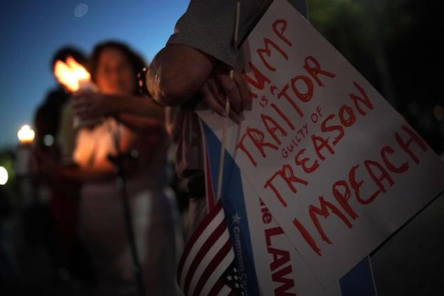 <p>Activists participate in a vigil in front of the White House, July 18, 2018, in Washington, D.C. (Photo: Alex Wong/Getty Images) </p>