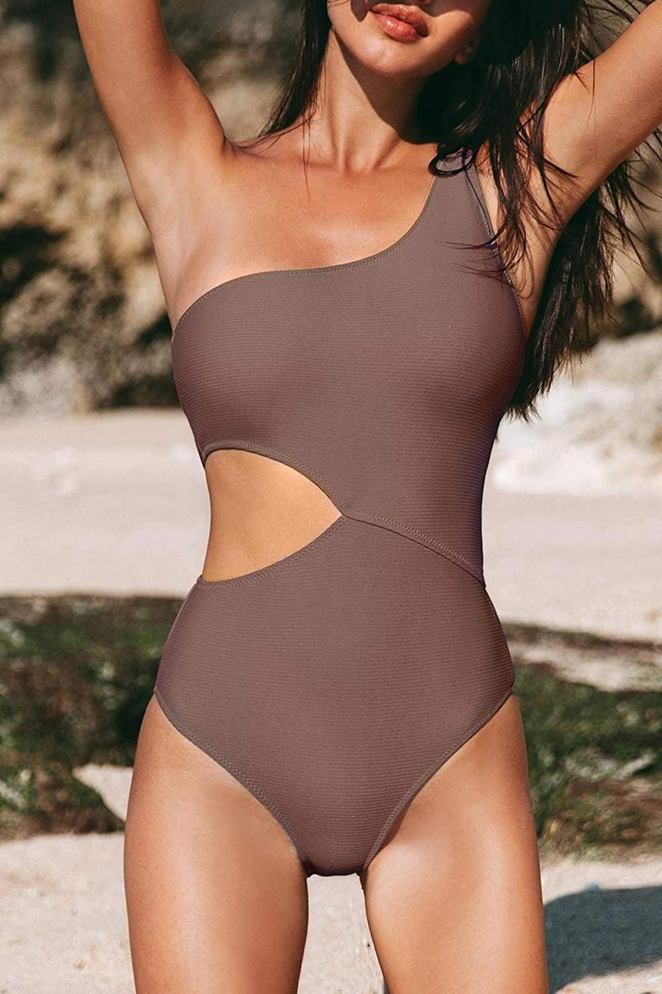 <p>You can't go wrong with the neutral toned <span>CUPSHE One Shoulder Cut Out Ribbed One Piece Swimsuit</span> ($29).</p>