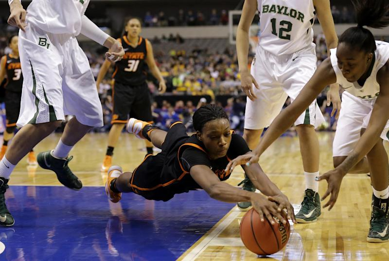 Oklahoma State forward Toni Young, center, dives to grab a loose ball against Baylor' Jordan Madden, right, as Baylor's Brittney Griner, top, left, Alexis Prince (12) and Oklahoma State's Kendra Suttles (31) watch in the second half of an NCAA college basketball game in the Big 12 Conference women's tournament Sunday, March 10, 2013, in Dallas. Baylor won 77-69. (AP Photo/Tony Gutierrez)