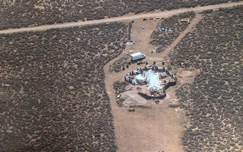 The remote New Mexico desert camp was raided by police on Friday - AFP