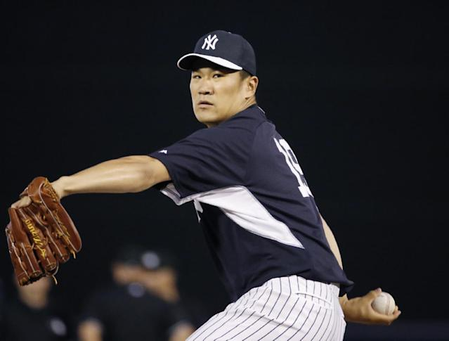 New York Yankees relief pitcher Masahiro Tanaka delivers a warmup pitch before relieving Hiroki Kuiroda in a spring exhibition baseball game against the Miami Marlins in Tampa, Fla., Friday, March 28, 2014. The Yankees defeated the Marlins 3-0. (AP Photo/Kathy Willens)