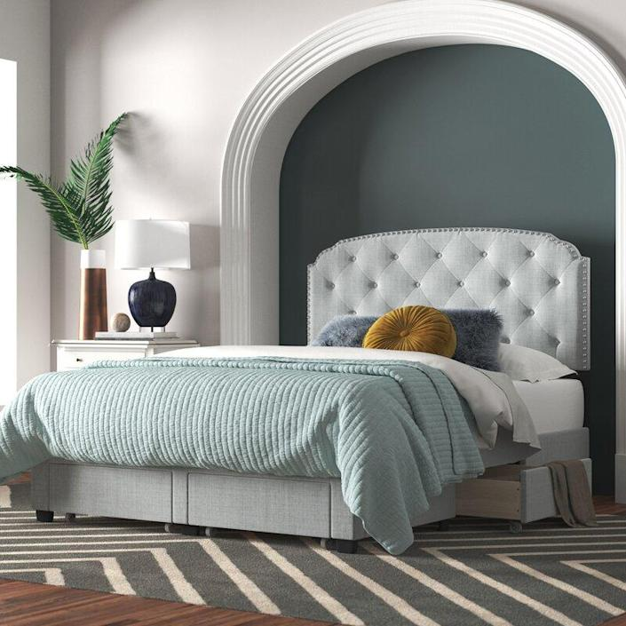 "<p>This upholstered beauty is <em>full</em> of extra storage. Not only are there two drawers at the foot of the bed, but there are also two drawers on the sides of the bed (one on each). The nailhead accents on the tufted headboard give it a luxe touch. </p> <p><strong>Sizes available:</strong> Twin, full, queen, and king</p> <p><strong>Stars:</strong> 4.3 out of 5</p> <p><strong>Customer Review:</strong> ""It is so beautiful and gives your room a touch of elegance! The installation of the drawers was complicated, but my husband got it done. We also added additional slats for extra support. Shipping was fast! I love this bed! I would definitely purchase it again!"" —<em>Alexis</em></p> $799, Joss & Main. <a href=""https://www.jossandmain.com/furniture/pdp/millicent-upholstered-storage-standard-bed-j001223097.html"" rel=""nofollow noopener"" target=""_blank"" data-ylk=""slk:Get it now!"" class=""link rapid-noclick-resp"">Get it now!</a>"