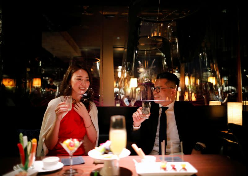 Tokyo bar uses 'fish bowl' screens to lure back virus-wary clients