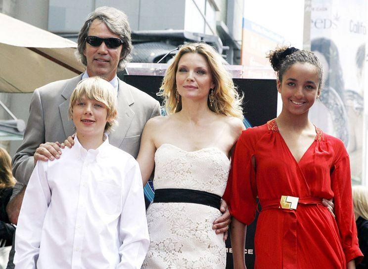 Michelle and her fam, also including son John, getting a star on the Hollywood Walk of Fame in 2007. (Photo: Kevin Winter/Getty Images)