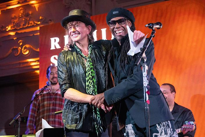 <p>Richie Sambora and Nile Rodgers share a moment during a concert at Bush Hall in London on Sept. 20.</p>