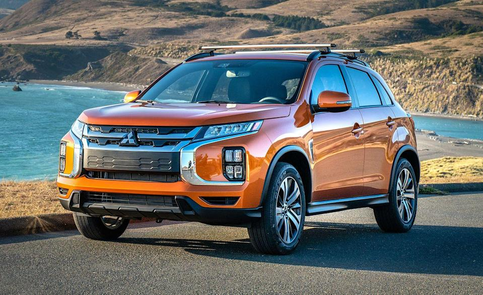 """<p>The <a href=""""https://www.caranddriver.com/mitsubishi/outlander-sport"""" rel=""""nofollow noopener"""" target=""""_blank"""" data-ylk=""""slk:Mitsubishi Outlander Sport"""" class=""""link rapid-noclick-resp"""">Mitsubishi Outlander Sport</a> is refreshed for this year, but the biggest of its updates are skin deep. Inside, the Outlander Sport can fit 19 carry-ons with its 60/40 split-folding rear seats set flat. The Outlander Sport also benefits from having a deep center console, but lacks door pockets for rear seat passengers. </p><ul><li>Base price: $22,090</li><li>Carry-on capacity, rear seats folded: 19 suitcases</li><li>Cargo volume, rear seats folded: 49 cubic feet<br></li><li>Cargo volume, behind rearmost row of seats: 21 cubic feet</li></ul><p><a class=""""link rapid-noclick-resp"""" href=""""https://www.caranddriver.com/mitsubishi/outlander-sport/specs"""" rel=""""nofollow noopener"""" target=""""_blank"""" data-ylk=""""slk:MORE OUTLANDER SPORT SPECS"""">MORE OUTLANDER SPORT SPECS</a></p>"""