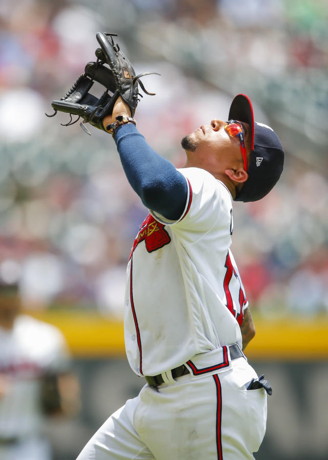Atlanta Braves third baseman Johan Camargo (17) catches a pop up for the final out of the seventh inning of a baseball game against the New York Mets, Wednesday, June 13, 2018, in Atlanta. The Atlanta Braves won the game 2-0. (AP Photo/Todd Kirkland)