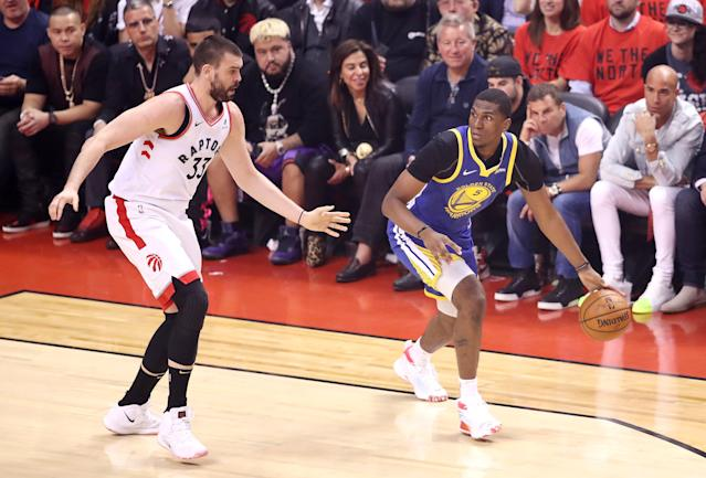 Kevon Looney #5 of the Golden State Warriors is defended by Marc Gasol #33 of the Toronto Raptors in the first half during Game Five of the 2019 NBA Finals at Scotiabank Arena on June 10, 2019 in Toronto, Canada. (Photo by Claus Andersen/Getty Images)