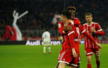 Soccer Football - Bundesliga - Bayern Munich vs Werder Bremen - Allianz Arena, Munich, Germany - January 21, 2018   Bayern Munich's Robert Lewandowski celebrates scoring their third goal with Kingsley Coman    REUTERS/Michaela Rehle