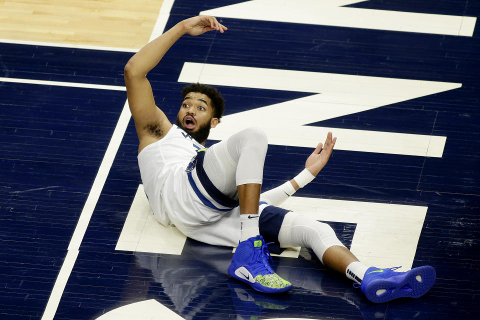 Minnesota Timberwolves center Karl-Anthony Towns (32) reacts to a foul call against the Chicago Bulls in the second quarter during an NBA basketball game, Sunday, April 11, 2021, in Minneapolis. (AP Photo/Andy Clayton-King)