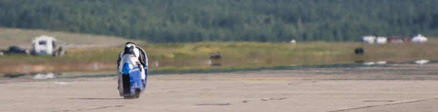 Bill Warner makes a run on his motorcycle during The Maine Event on a runway at a former air base Sunday, July 14, 2013, at Limestone, Maine. Warner, 44, of Wimauma, Fla., died Sunday after losing control and zooming off a runway on a later run. (AP Photo/Peter Freeman) NO SALES