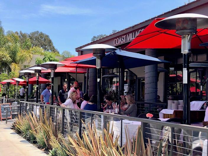 People drinking wine outside in Montecito