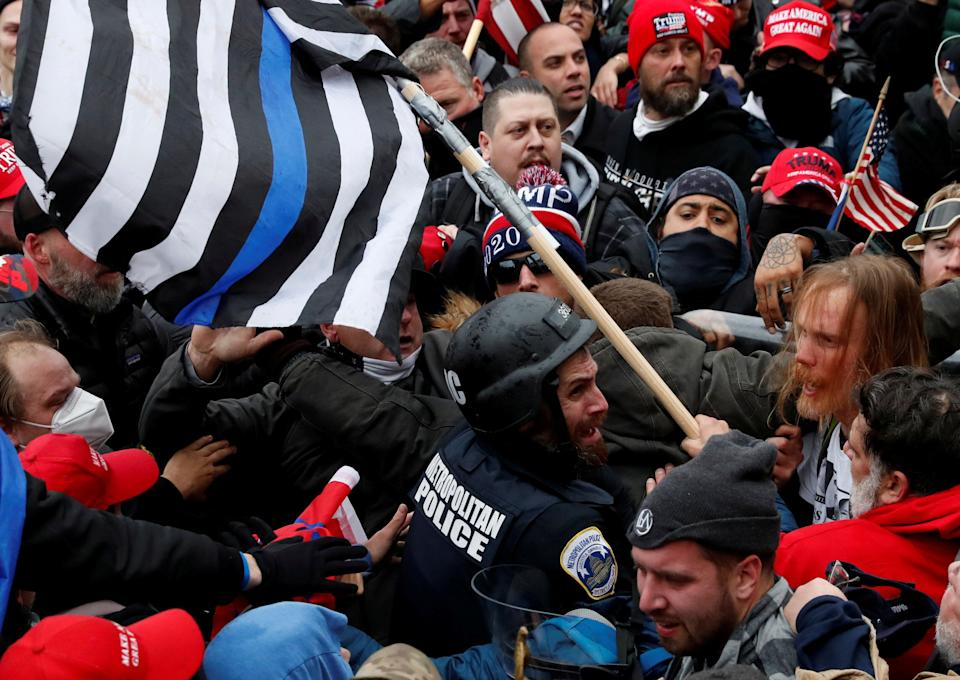 Pro-Trump protesters clash with D.C. police officer Michael Fanone at a rally to contest the certification of the 2020 presidential election results by Congress on Jan. 6. (Photo: Shannon Stapleton/Reuters)