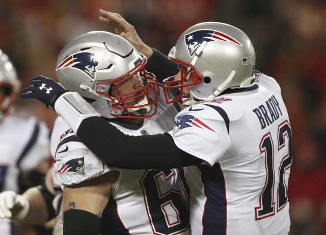 New England Patriots quarterback Tom Brady celebrates with center David Andrews (60) after throwing a touchdown pass against the Chiefs. (AP)