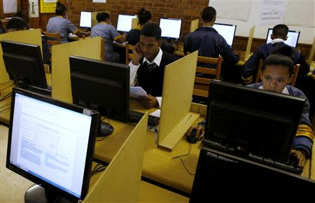 Students use computers to study at Elswood Secondary School in Cape Town November 7, 2013. REUTERS/Mike Hutchings