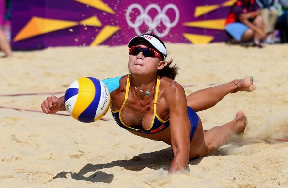 LONDON, ENGLAND - JULY 30:  Chen Xue of China dives for a shot during her Women's Beach Volleyball Preliminary match with Xi Zhang of China against Simone Kuhn and Nadine Zumkehr of Switzerland on Day 3 of the London 2012 Olympic Games at Horse Guards Parade on July 30, 2012 in London, England.  (Photo by Ryan Pierse/Getty Images)