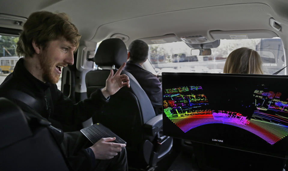 FILE - In this Monday, April 10, 2017 file photo, Luminar CEO Austin Russell monitors a 3D lidar map on a demonstration drive in San Francisco. Russell, now 22, was barely old enough to drive when he set out to create a safer navigation system for robot-controlled cars. His ambitions are about to be tested five years after he co-founded Luminar Technologies, a Silicon Valley startup trying to steer the rapidly expanding self-driving car industry in a new direction. (AP Photo/Ben Margot)