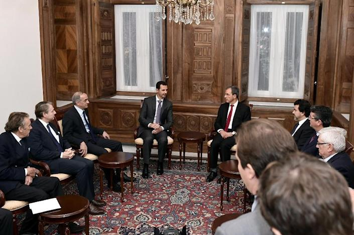 A handout picture provided by the Syrian Arab News Agency shows President Bashar al-Assad (C-L) speaking with French National Assembly member Thierry Mariani (C-R), the president of a delegation of parliamentarians, in Damascus on November 14, 2015 (AFP Photo/)