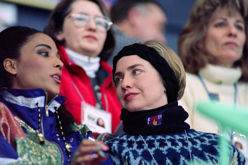 First lady Hillary Clinton speaks to American athlete Florence Griffith Joyner on Feb. 14, 1994, at the Olympic Hall during the 1994 Winter Olympics in Lillehammer, Norway.