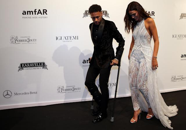 Soccer player Neymar and his girlfriend Bruna Marquezine arrive at the eighth annual amfAR Gala Sao Paulo in Sao Paulo, Brazil April 13, 2018. REUTERS/Paulo Whitaker