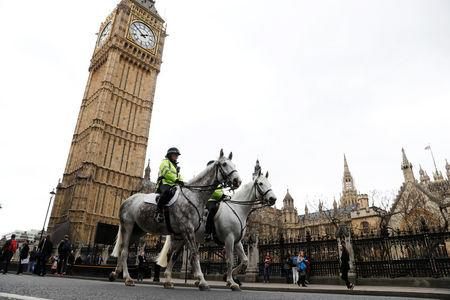 Police on horseback patrol near Westminster Bridge in London