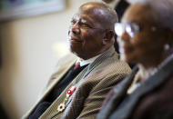 FILE- In this Jan. 14, 2016, file photo, Hank Aaron, left, looks on with wife Billye during a ceremony presenting him the Order of the Rising Sun, Gold Rays with Rosette, by the Consul General of Japan at his official residence in Atlanta. Hank Aaron, who endured racist threats with stoic dignity during his pursuit of Babe Ruth but went on to break the career home run record in the pre-steroids era, died early Friday, Jan. 22, 2021. He was 86. The Atlanta Braves said Aaron died peacefully in his sleep. No cause of death was given. (AP Photo/David Goldman, File)