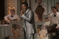 """This image released by Amazon Studios shows Leslie Odom Jr. in a scene from """"One Night in Miami."""" Odom was nominated for a Golden Globe for best supporting actor in a motion picture on Wednesday, Feb. 3, 2021 for his role in the film. (Patti Perret/Amazon Studios via AP)"""