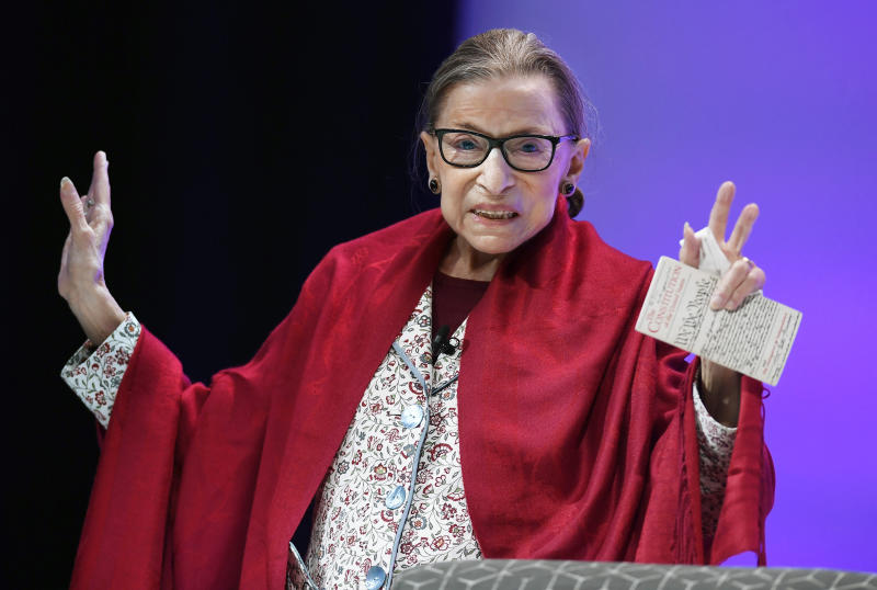 U.S. Supreme Court Justice Ruth Bader Ginsburg gestures to students before she speaks at Amherst College in Amherst. Source: AP