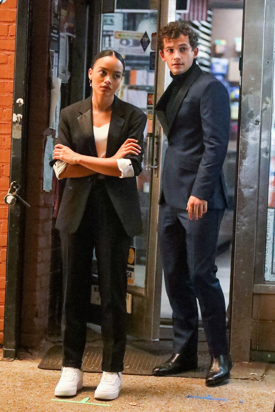 <p>Whitney Peak sports a blazer, black trousers, white tee and sneakers. Eli Brown buttons up in a navy suit and black turtleneck.</p>