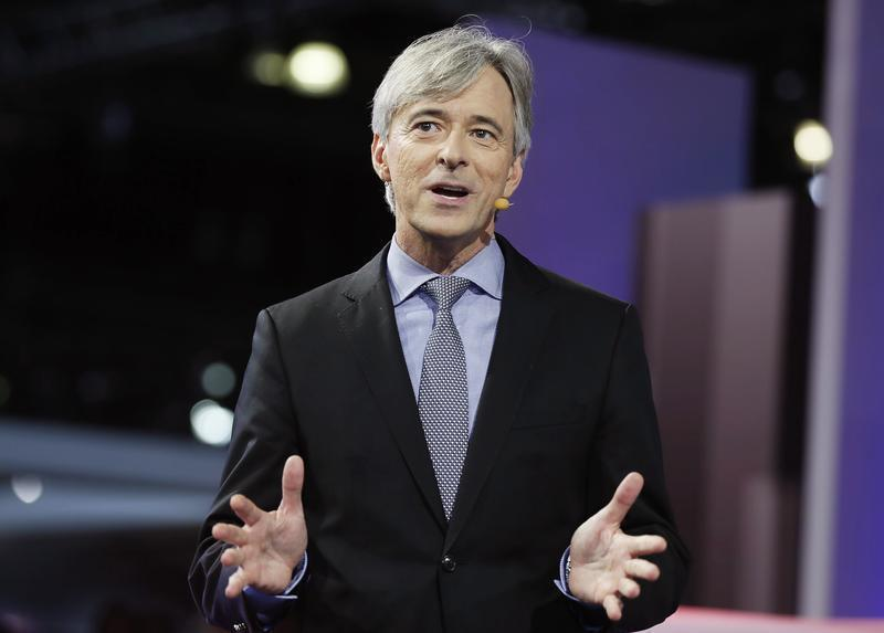 John Krafcik, president and CEO of Hyundai America introduces the company's new cars during the 2013 Los Angeles Auto Show in Los Angeles