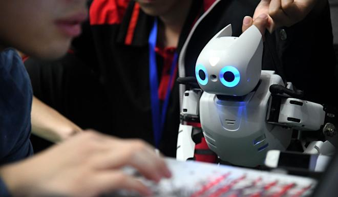 A contestant experimenting with a robot during a hi-tech competition in Qingdao in Shandong Province in October 2019. Photo: Xinhua