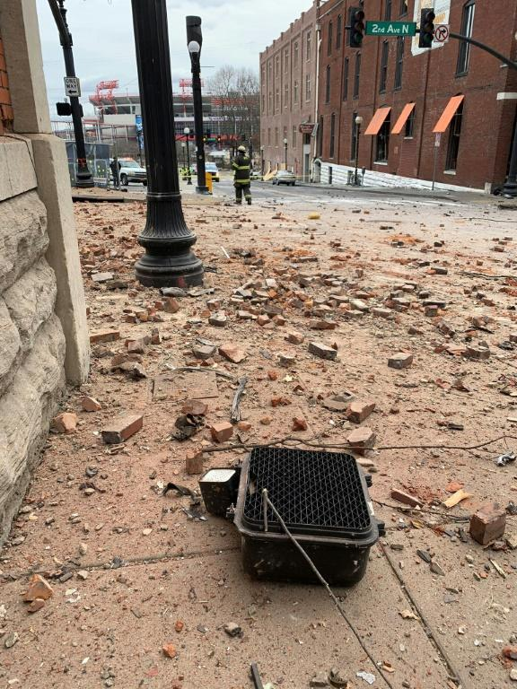 In this photo from the Twitter page of the Nashville Fire Department, bricks and pieces of a crosswalk sign are seen on 2nd Avenue North after a motorhome exploded in Nashville, Tennessee