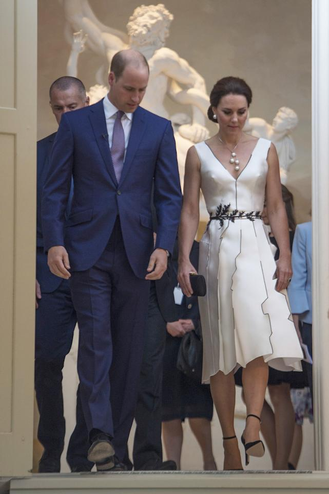 <p>Kate dressed diplomatically for an evening event in Poland, turning to Polish designer <span>Gosia Baczynska. The designer, who's well known within Poland, created a monochrome, satin number for the Duchess complete with embroidered waistline. <br /><em>[Photo: PA]</em><br /></span> </p>