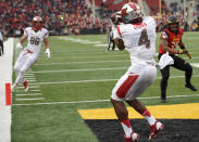 Rutgers wide receiver Leonte Carroo (4) catches a touchdown pass against Maryland linebacker Alex Twine (35) during the first half of an NCAA college football game, Saturday, Nov. 29, 2014, in College Park, Md. Rutgers tight end Tyler Kroft (86) looks on. (AP Photo/Nick Wass)