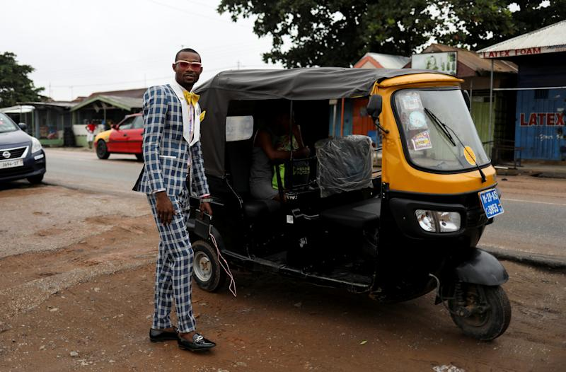 A pastor as he is about to be transported to church in Kumasi, in the Ashanti region, Ghana. (Photo: Siphiwe Sibeko/Reuters)