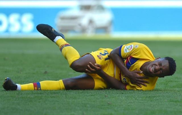 Guinea-Bissau teenager Ansu Fati falls with a shoulder injury while playing for Barcelona against Osasuna at the weekend (AFP Photo/ANDER GILLENEA)
