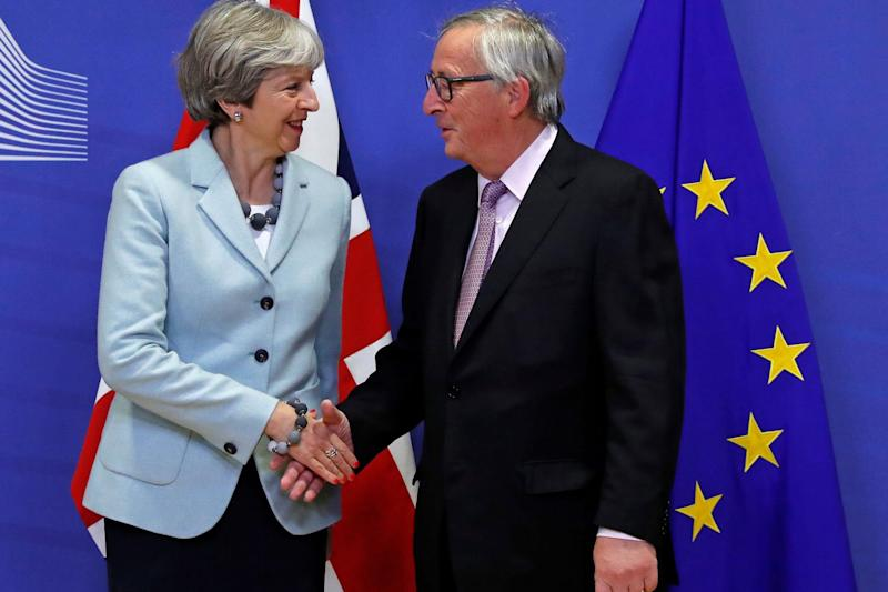 Prime Minister Theresa May shakes hands with Jean-Claude Juncker: Reuters