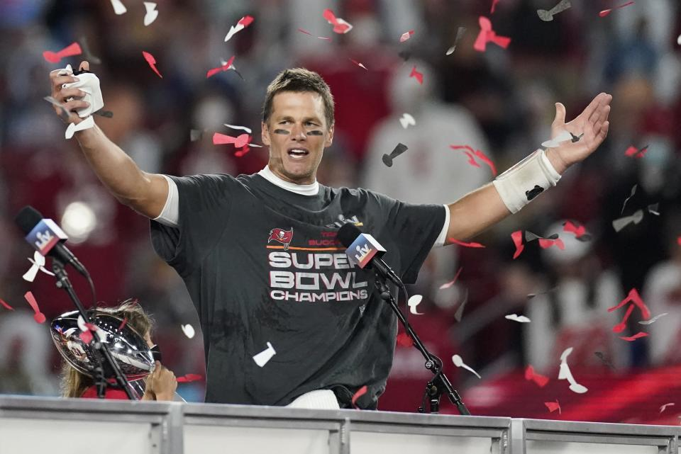 FILE - Tampa Bay Buccaneers quarterback Tom Brady celebrates after defeating the Kansas City Chiefs in the NFL Super Bowl 55 football game in Tampa, Fla., in this Sunday, Feb. 7, 2021, file photo. Jason Licht is enjoying the perks that come with being the general manager of a reigning Super Bowl champion. That includes the challenge of getting a late start on preparing for the NFL draft and not having a selection until the tail end of the first round as the Buccaneers continue to get acclimated to what life's like with Tom Brady. (AP Photo/Ashley Landis, File)