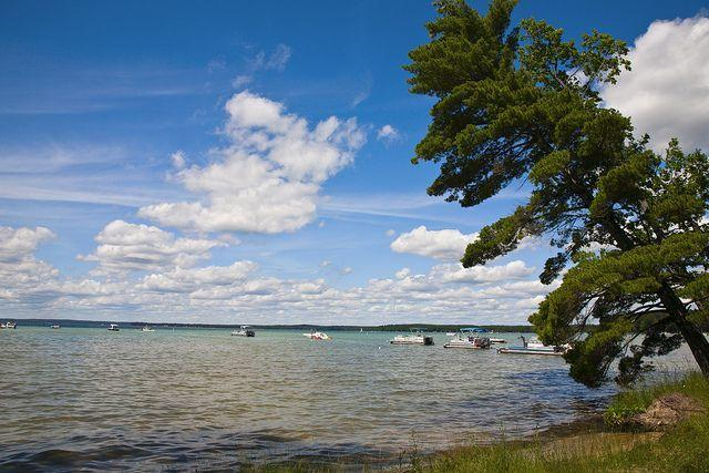 """<p>You don't need to head to a tropical island to enjoy clear waters. Instead, head to Higgins Lake, which has crystal-clear water that often appears the <a href=""""http://www.onlyinyourstate.com/michigan/sapphire-lake-mi/"""" rel=""""nofollow noopener"""" target=""""_blank"""" data-ylk=""""slk:color of a sapphire gem"""" class=""""link rapid-noclick-resp"""">color of a sapphire gem</a>. (Flickr photo by <a href=""""https://flic.kr/p/8ewvRv"""" rel=""""nofollow noopener"""" target=""""_blank"""" data-ylk=""""slk:George Thomas"""" class=""""link rapid-noclick-resp"""">George Thomas</a><span class=""""redactor-invisible-space"""">)</span></p>"""