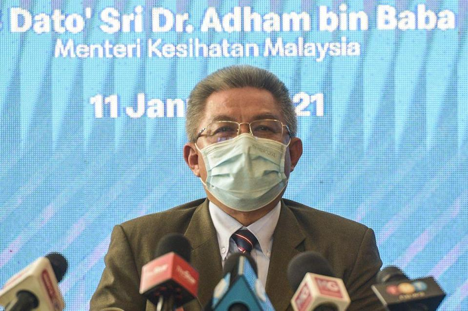 Health Minister Datuk Seri Dr Adham Baba says the government is working to revise the Emergency Ordinance to empower general practitioners in the private sector to issue home quarantine orders on people suspected of contracting Covid-19. — Picture by Miera Zulyana