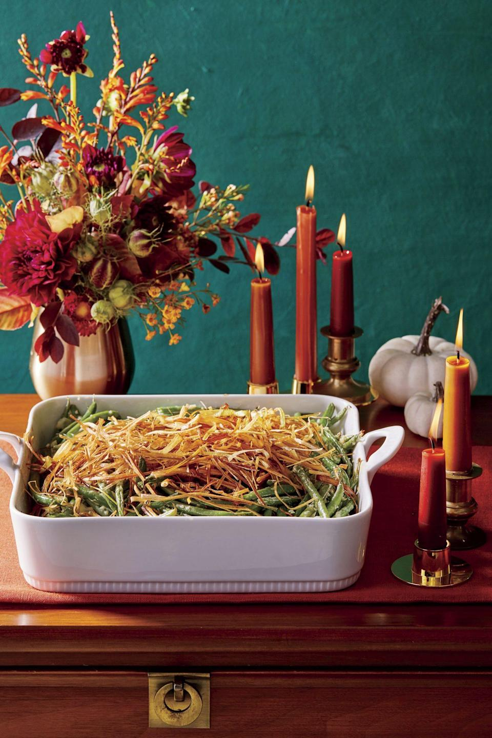 """<p><strong>Recipe: <a href=""""https://www.southernliving.com/recipes/homemade-green-bean-casserole-with-leeks"""" rel=""""nofollow noopener"""" target=""""_blank"""" data-ylk=""""slk:Green Bean Casserole with Crispy Leeks"""" class=""""link rapid-noclick-resp"""">Green Bean Casserole with Crispy Leeks</a></strong></p> <p>This updated take on classic green bean casserole deserves a spot on your table this season. Crispy leeks on top set it off in a way store-bought fried onions never could. </p>"""