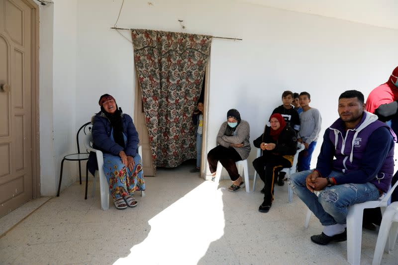 The family of Brahim Aouissaoui, suspected of Thursday's attack in Nice, France, sit in their home in Thina, a suburb of Sfax, Tunisia