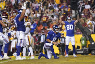 New York Giants quarterback Daniel Jones (8) stands up and running in to score a touchdown against the Washington Football Team during the first half of an NFL football game, Thursday, Sept. 16, 2021, in Landover, Md. (AP Photo/Alex Brandon)