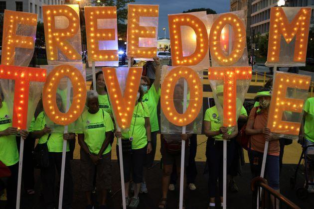 Voting rights activists during a candlelight vigil marking the first anniversary of Rep. John Lewis' (D-Ga.) death and advocating for the passage of voting rights legislation he helped to write. (Photo: Alex Wong via Getty Images)