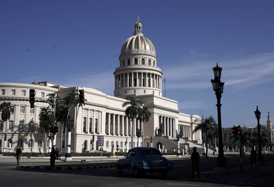 Police stand guard near the National Capitol building in Havana, Cuba, Monday, July 12, 2021, the day after protests against food shortages and high prices amid the coronavirus crisis. (AP Photo/Eliana Aponte)