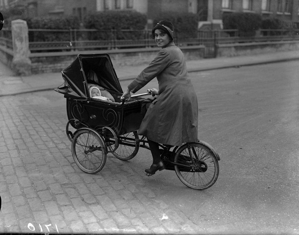 <p>Multi-tasking as a mom looked slightly different in the 1920s. In this photo, a mom gets some exercise with an innovative cycle pram that allows her to ride a bike and take baby for a walk at the same time. A little bulky, but it gets the job done!<br></p>