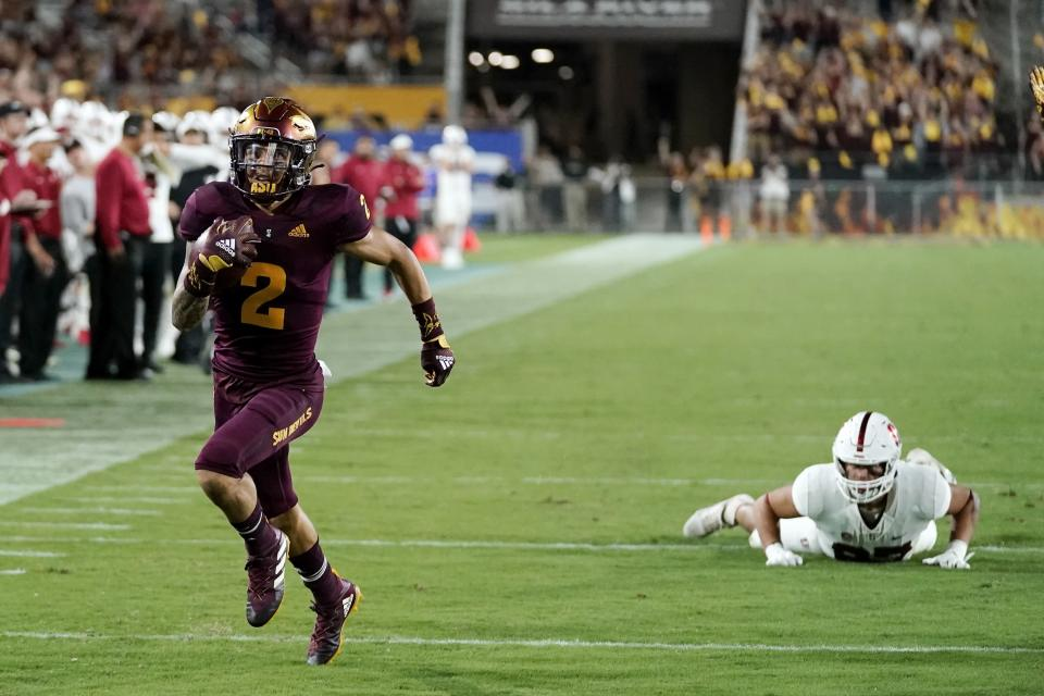 Arizona State defensive back DeAndre Pierce (2) returns a lateral after an interception for a touchdown, getting past Stanford tight end Bradley Archer, right, during the second half of an NCAA college football game Friday, Oct. 8, 2021, in Tempe, Ariz. Arizona State won 28-10. (AP Photo/Ross D. Franklin)