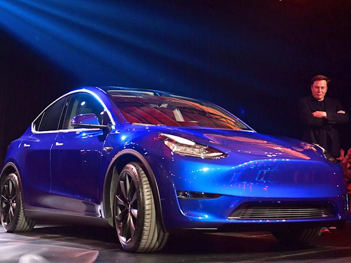 Tesla CEO Elon Musk views the new Tesla Model Y at its unveiling in Hawthorne, California on March 14, 2019.
