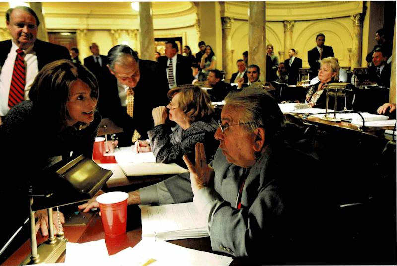 Practicing the politics of persuasion. I'm on the Senate floor trying to wrangle a yes vote on the school funding bill from Republican Sen. Joseph A. Palaia, with Senate President Dick Codey looking on. In the end Sen. Palaia switched his no vote to a yes. (Photo: Photo Courtesy of Barbara Buono)